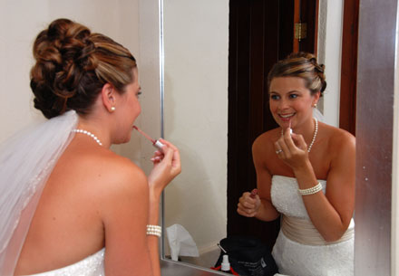 applying some make up before the wedding