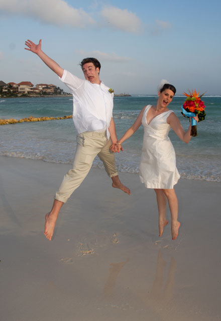 couple jumping in the beach