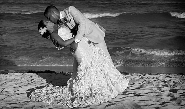 Passionate kiss at the beach